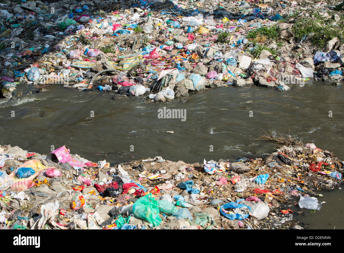The Bagmati river running through Kathmandu in Nepal. The river is full of litter and raw sewage - Stock Image