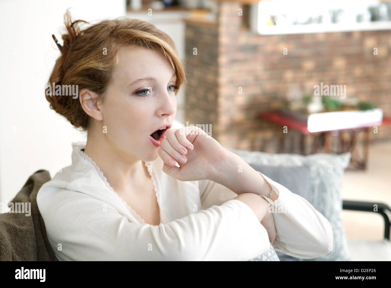 YAWNING WOMAN - Stock Image