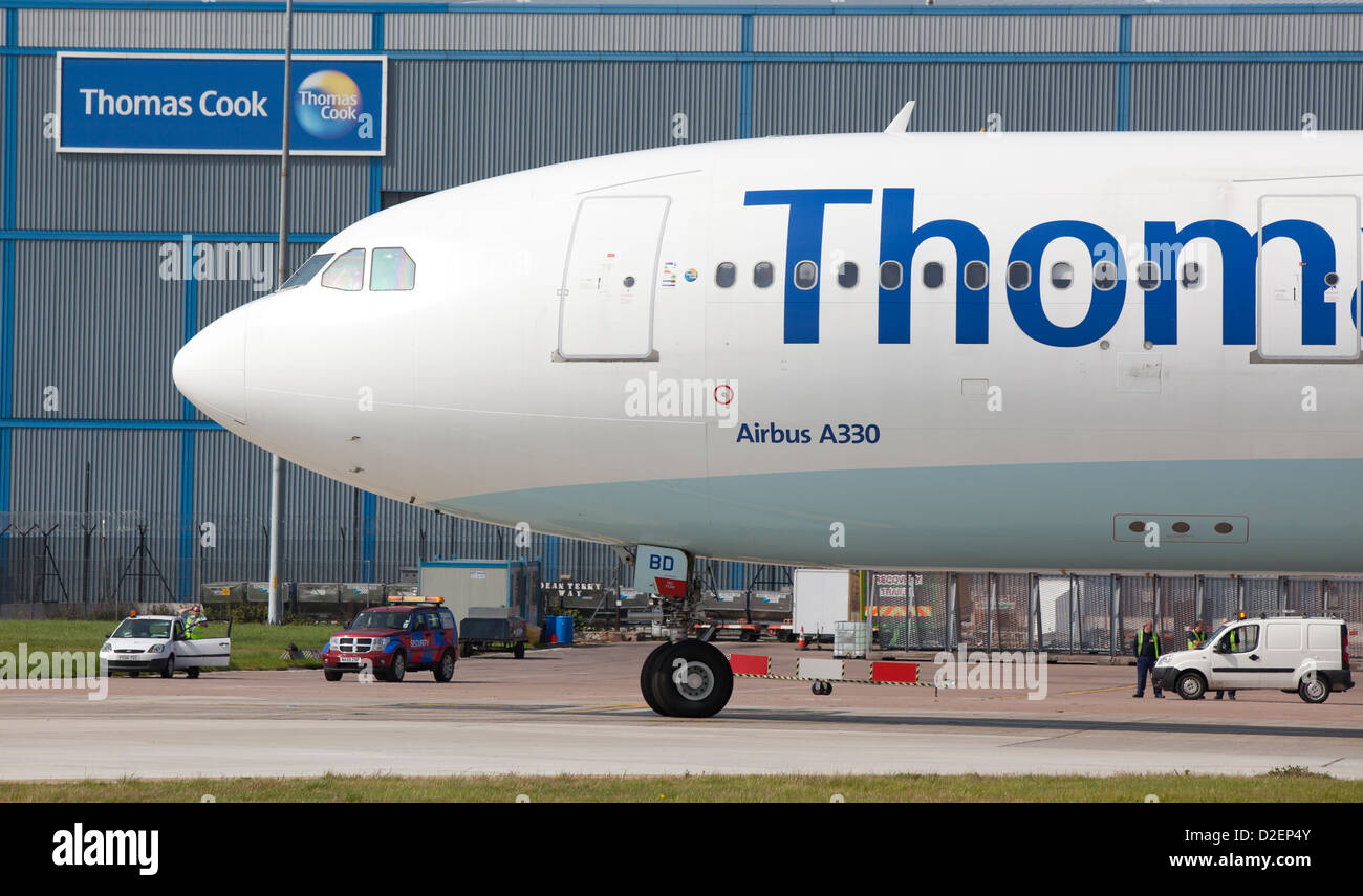 https://c8.alamy.com/comp/D2EP4Y/airbus-a330-thomas-cook-plane-passing-the-thomas-cook-hanger-at-manchester-D2EP4Y.jpg