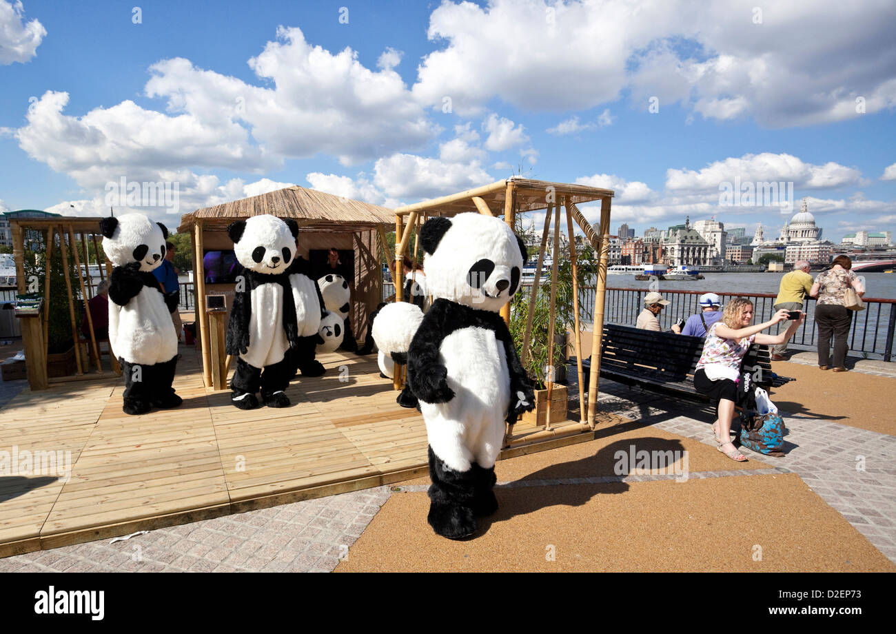 Promoters in panda bear costumes at South Bank, London, England, UK - Stock Image