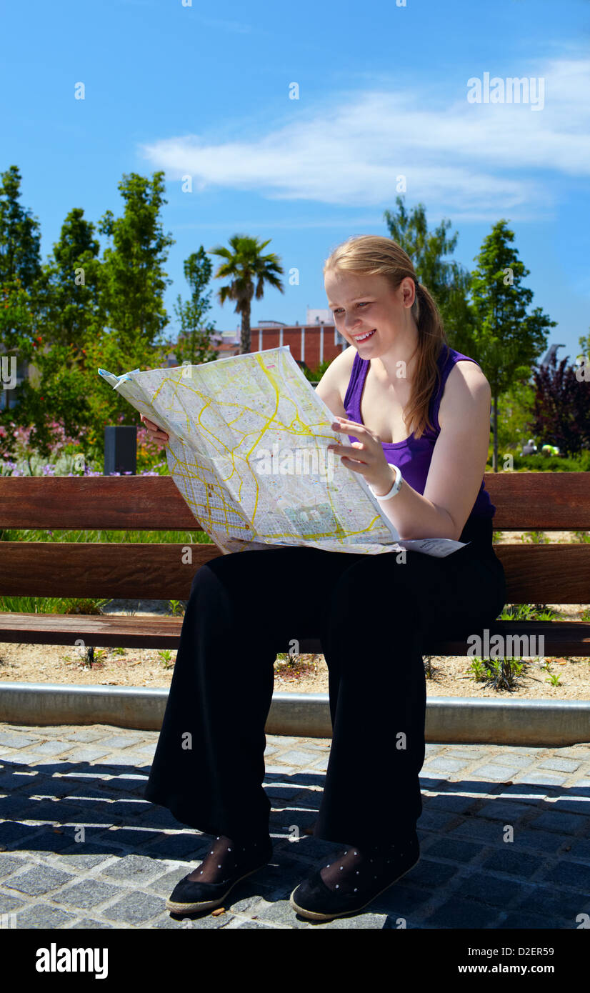Girl is reading the map. - Stock Image