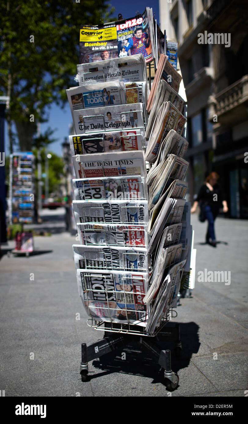A newspaper pole on a street - Stock Image