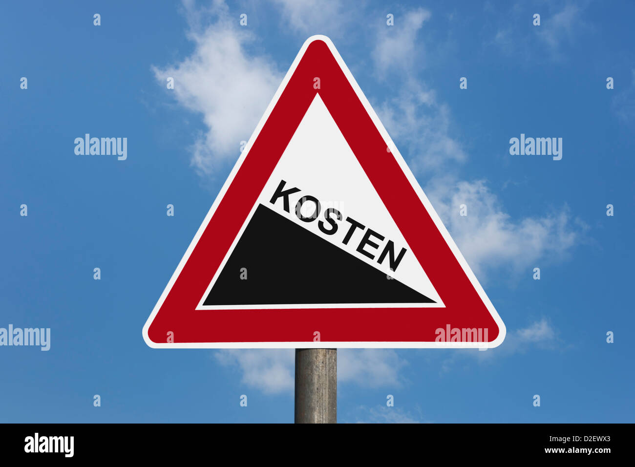 Detail photo of a danger sign 'Steep hill downwards' with the German inscription costs - Stock Image