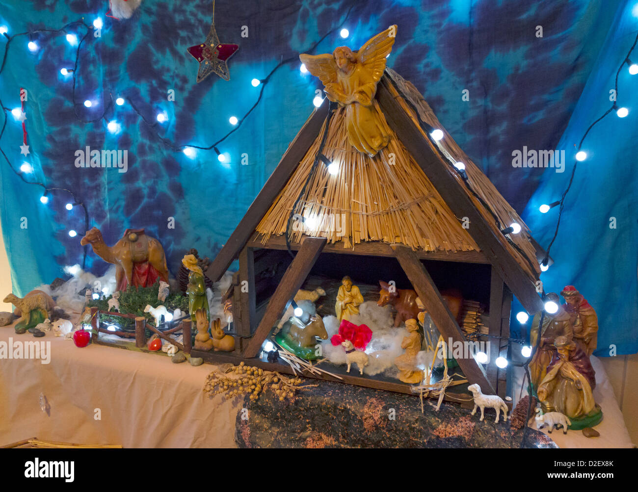 A domestic Christmas crib nativity scene with multiple characters - Stock Image