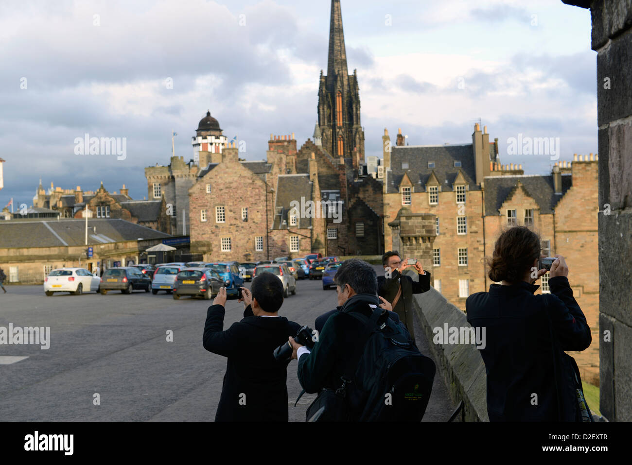 Malaysian tourist take pictures of view from Edinburgh Castle - Stock Image