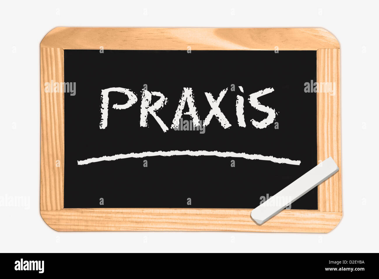 Detail photo of a Chalkboard with the German inscription practice, white chalk lies in a corner Stock Photo