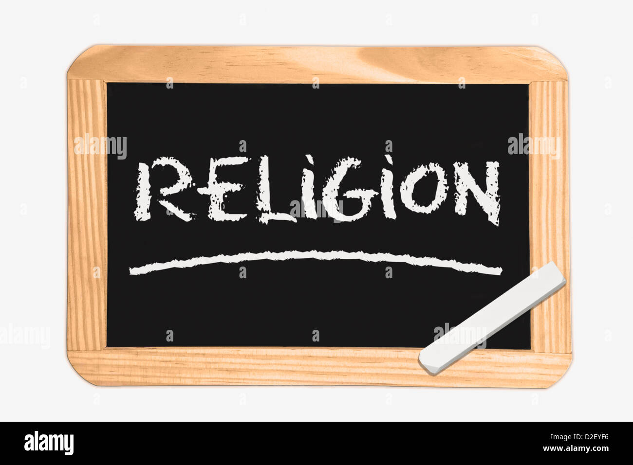 Detail photo of a Chalkboard with the German inscription religion, white chalk lies in a corner - Stock Image