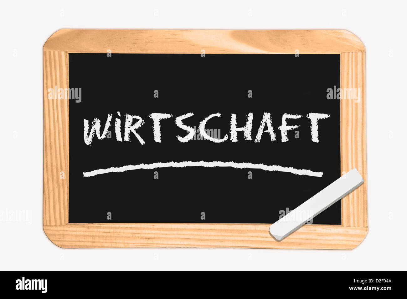 Detail photo of a Chalkboard with the German inscription economy, white chalk lies in a corner Stock Photo