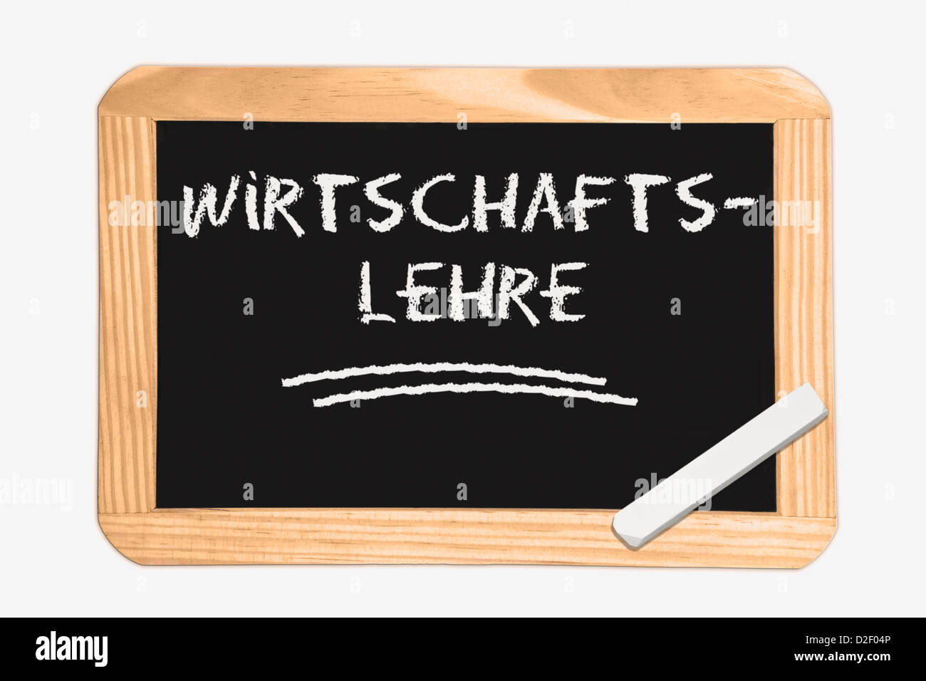 Detail photo of a Chalkboard with the German inscription business studies, white chalk lies in a corner - Stock Image