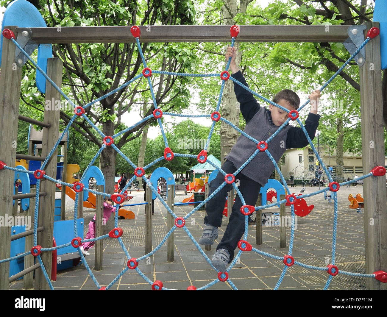 6-year-old boy playing in a park Paris. France. - Stock Image