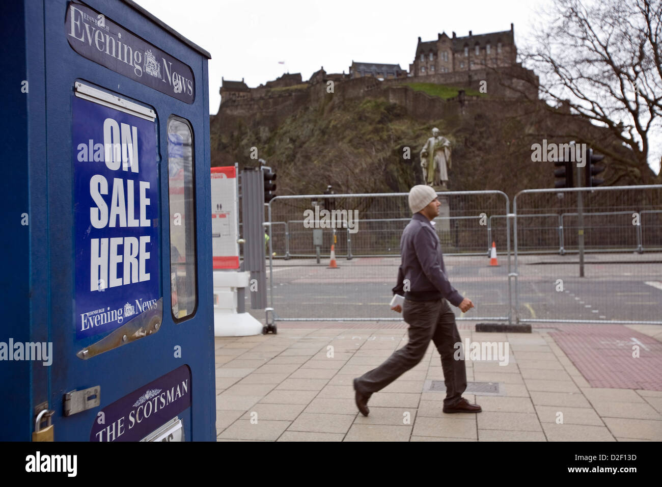 Vendor selling The Scotsman and Edinburgh Evening News newspapers from a booth on Princes Street, Edinburgh - Stock Image