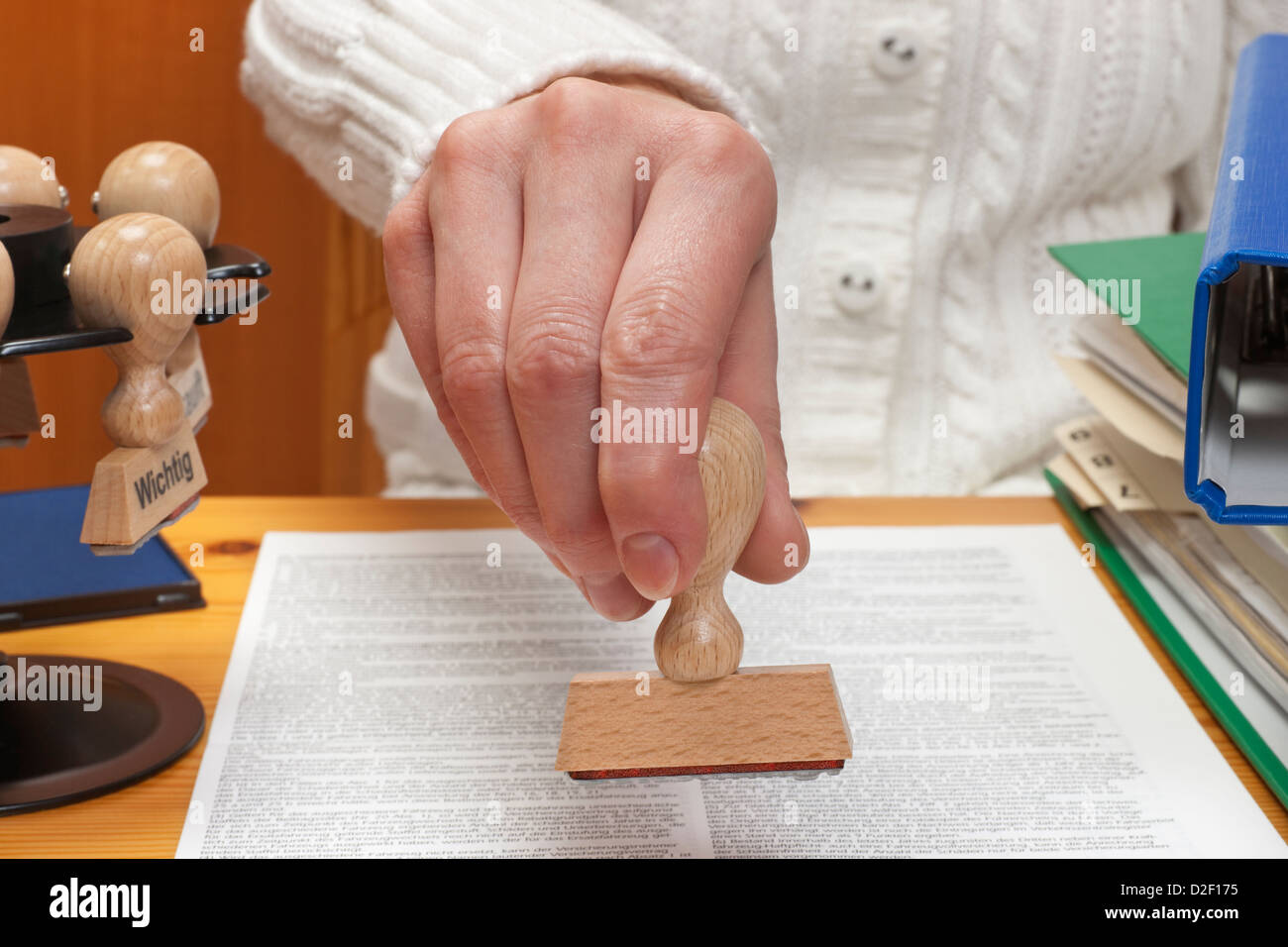 a stamp without inscription allowed is held in the hand Stock Photo