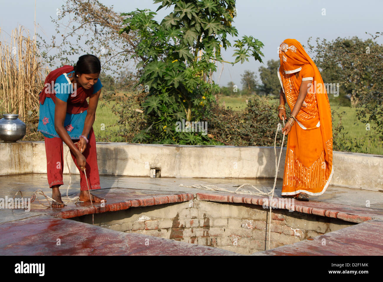 Women fetching water . Mathurai. India. - Stock Image