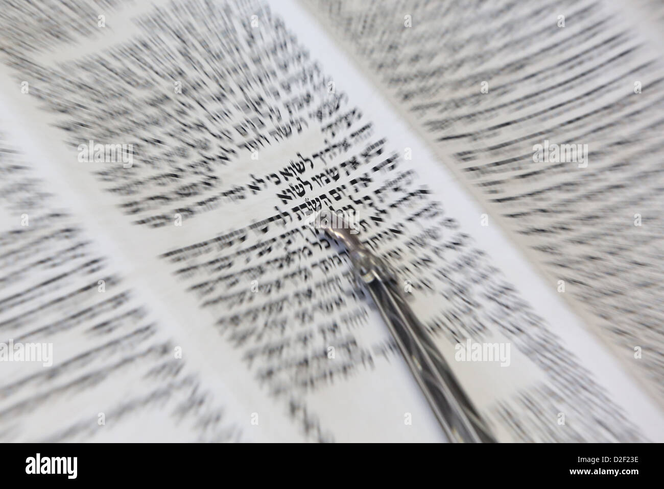 Jewish torah scroll with pointer. The word Shabbat in hebrew. Paris. France. - Stock Image