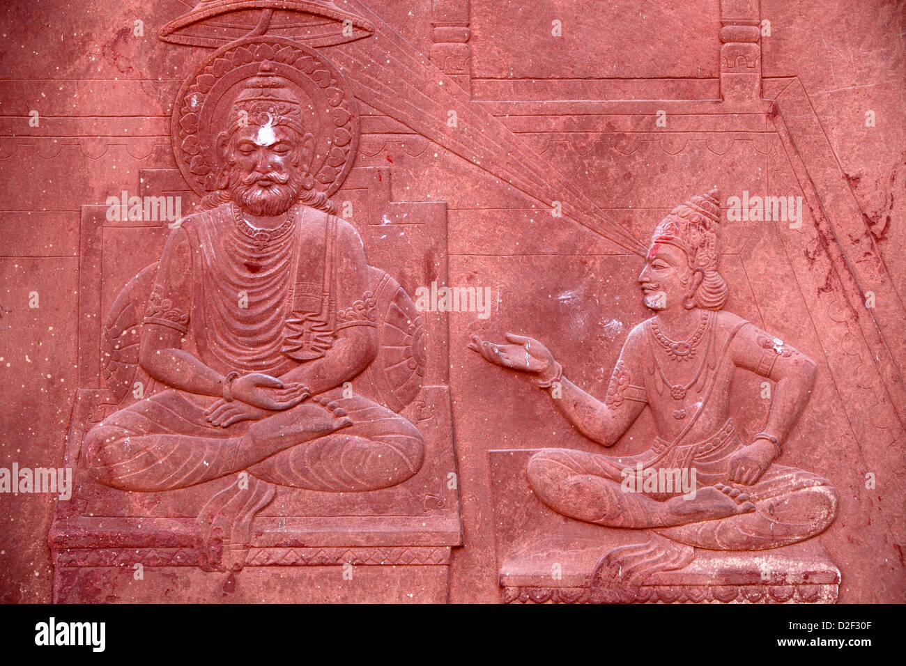 Bhagavad Gita engraved on a Hindu temple : dialogue between Krishna and Arjuna Vrindavan. India. - Stock Image
