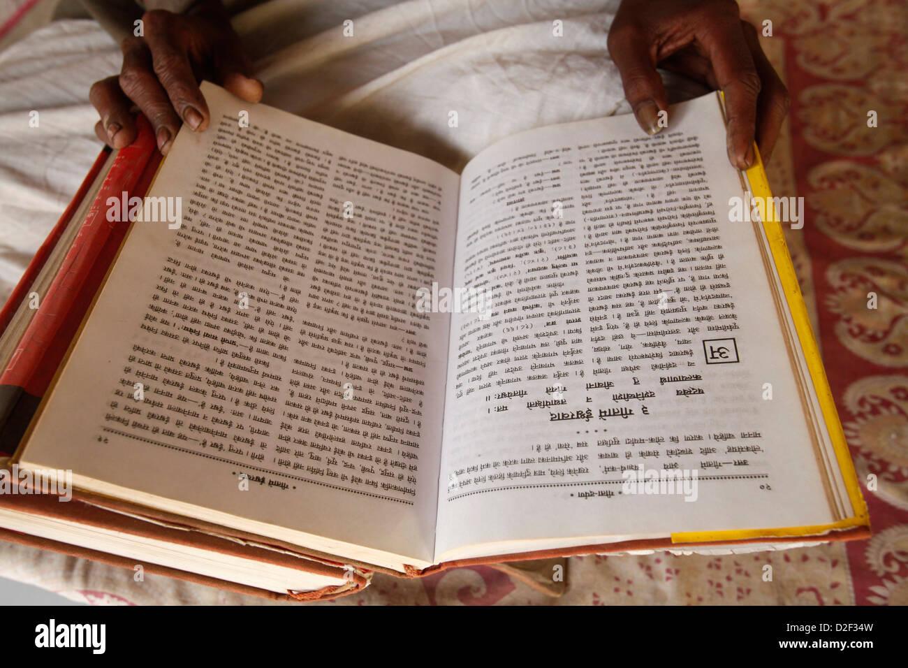 Temple priest reading the Bhagavad Gita Goverdan. India. - Stock Image