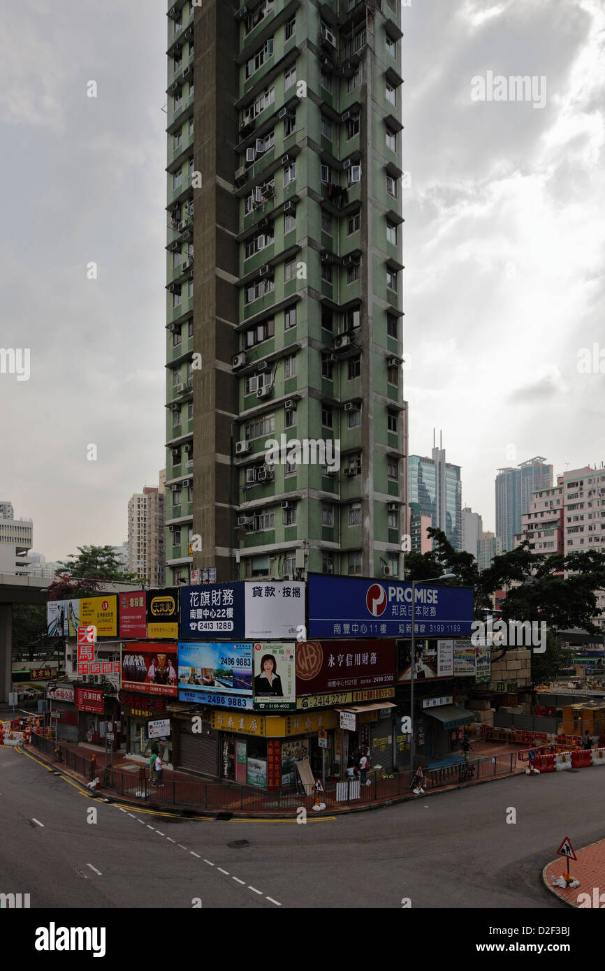 Hong Kong, China, impoverished housing tower on a street corner in Tsuen Wan - Stock Image