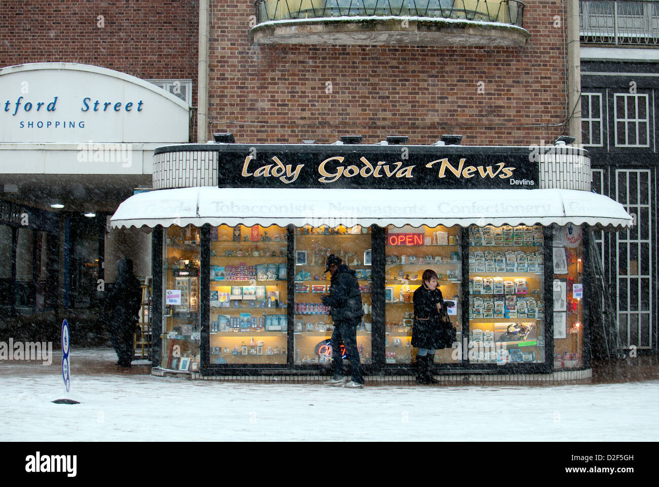 Newsagents shop, Broadgate, in snowy weather, Coventry, UK Stock Photo