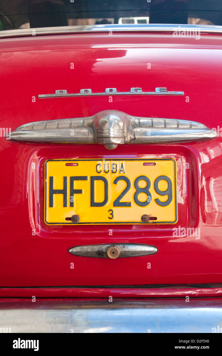 Cuban License Plate on the boot of an Old American Red Dodge Car, Havana, Cuba - Stock Image