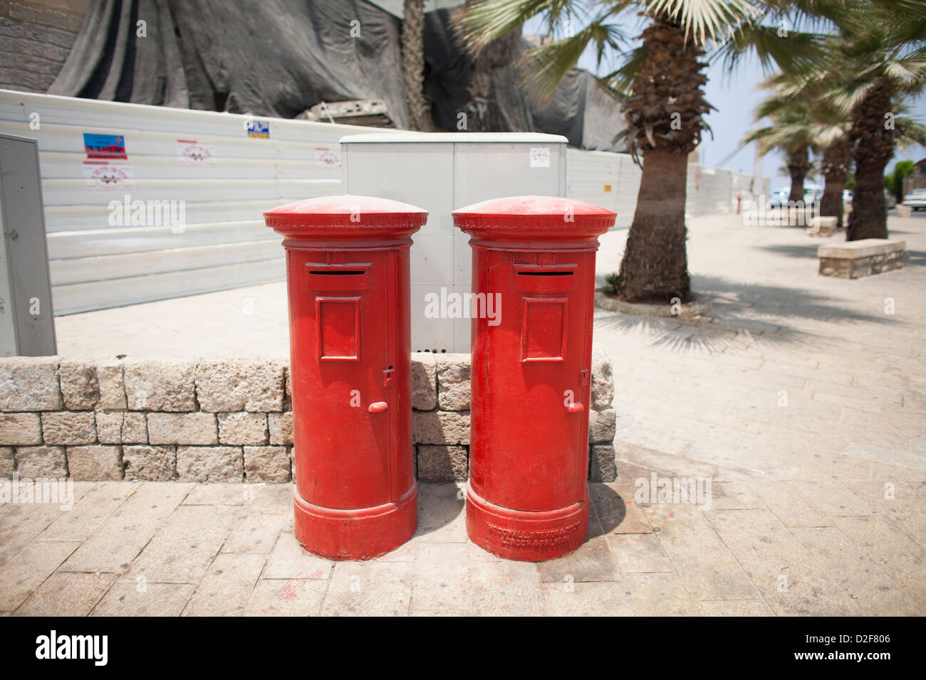 A pair of traditional British red pillar postboxes on a street in Israel. - Stock Image