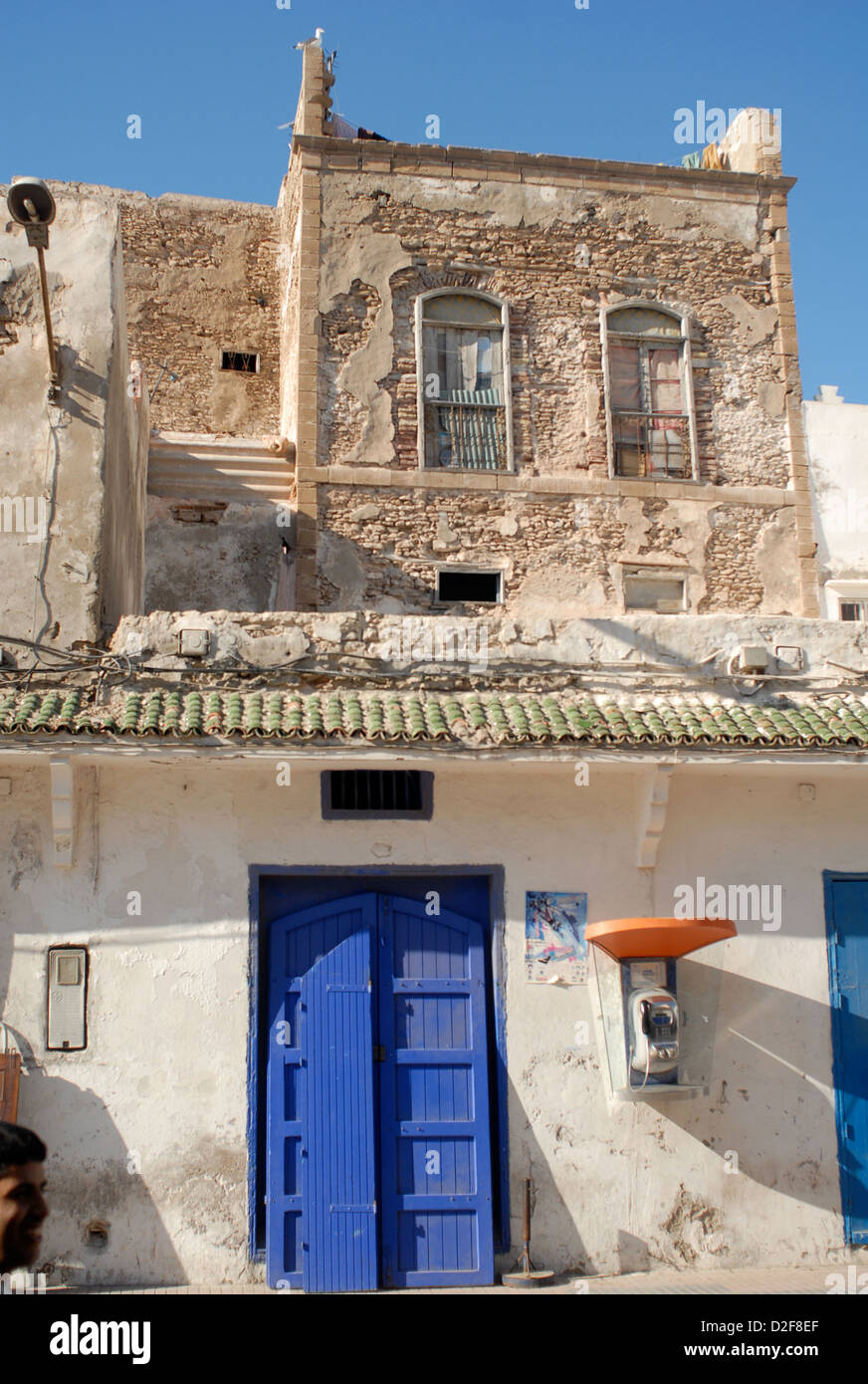 old weathered shop with public telephone kiosk on avenue mohammed zerktouni in esaouira morocco - Stock Image
