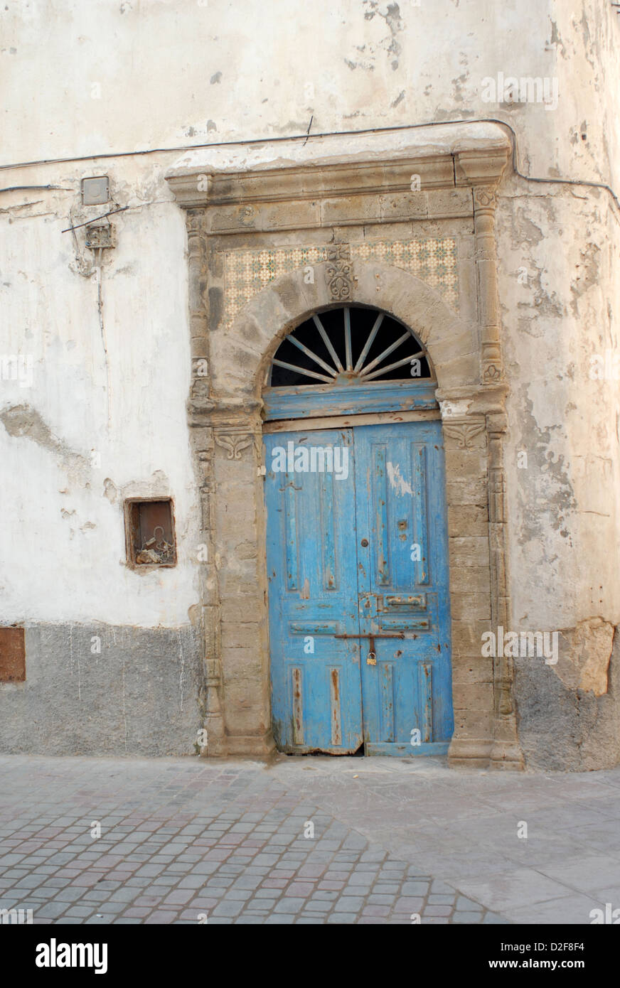 old weather-beaten door in the medina of essaouira morocco - Stock Image