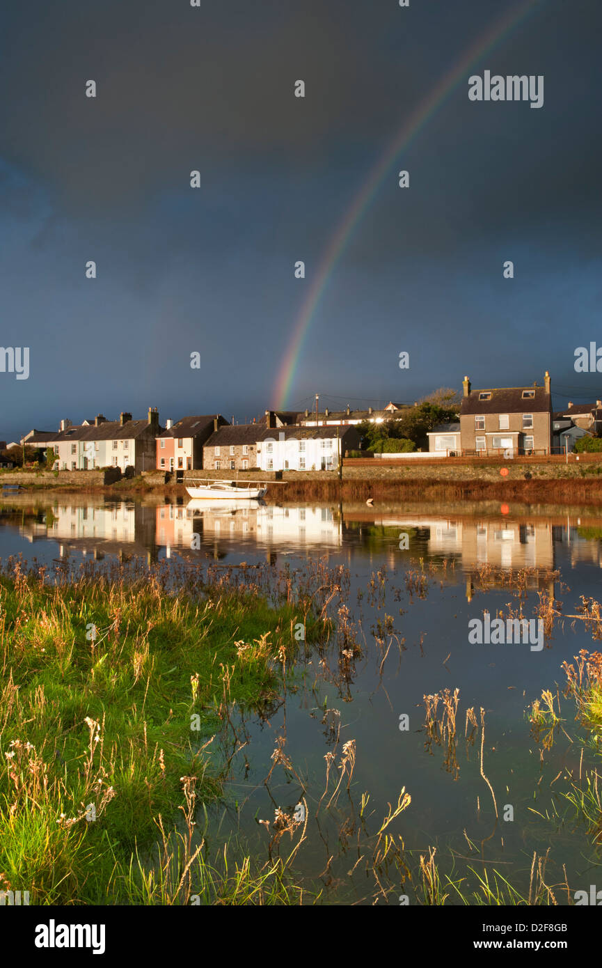 Storm Clouds and Rainbow over Afon Ffraw & Riverside Cottages, Aberffraw, Anglesey, North Wales, UK - Stock Image