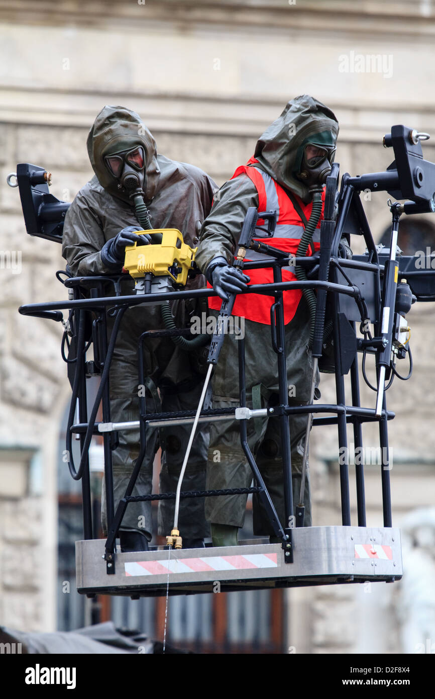 Two soldiers from a biological and nuclear unit preparing to clean something - Stock Image