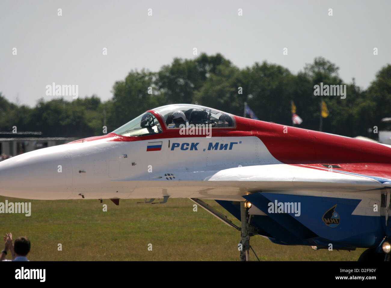 Mikoyan MiG-29 on airfield pilot in cockpit Stock Photo: 53196779