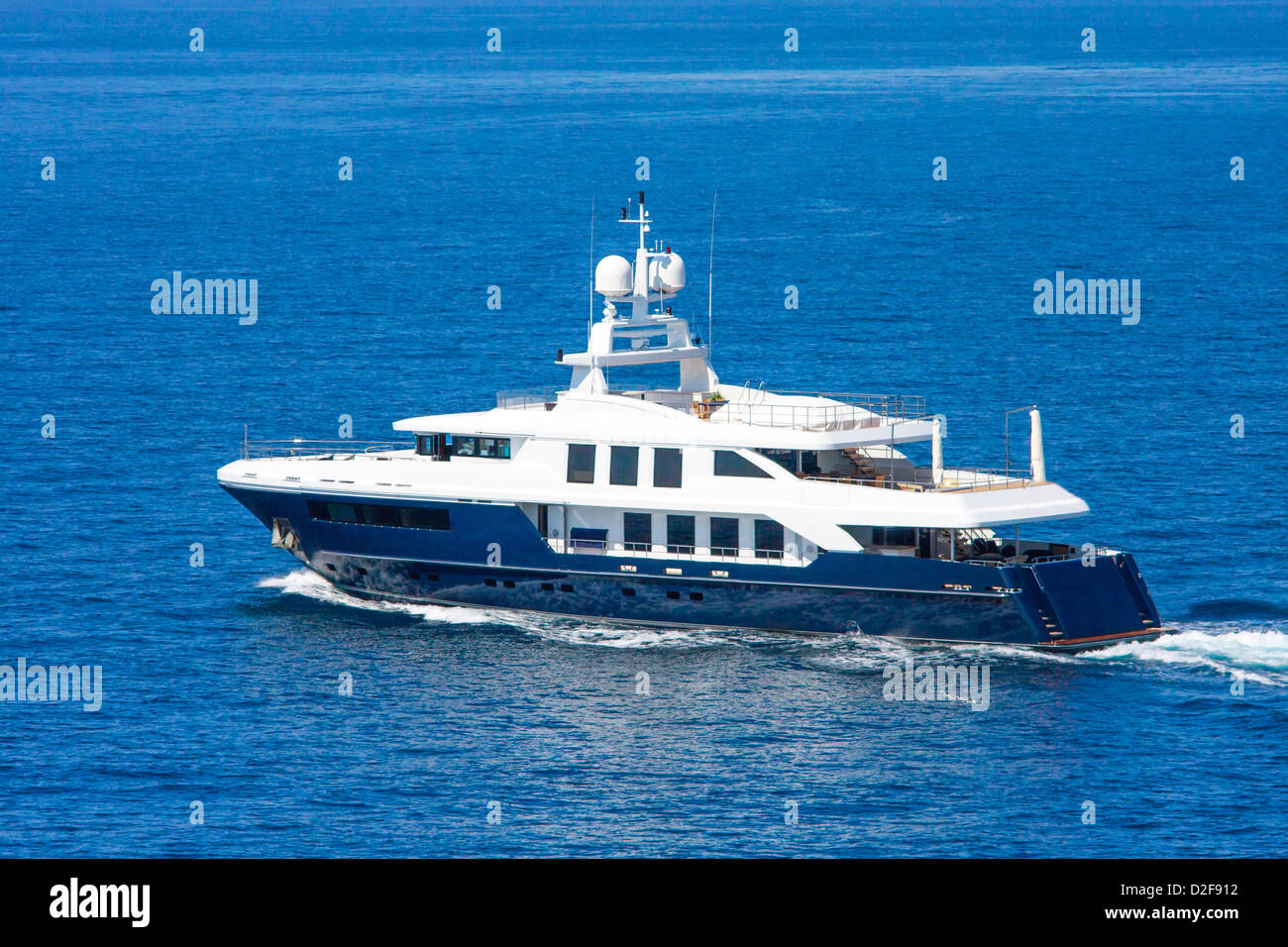 A large private motor yacht under way out at sea - Stock Image