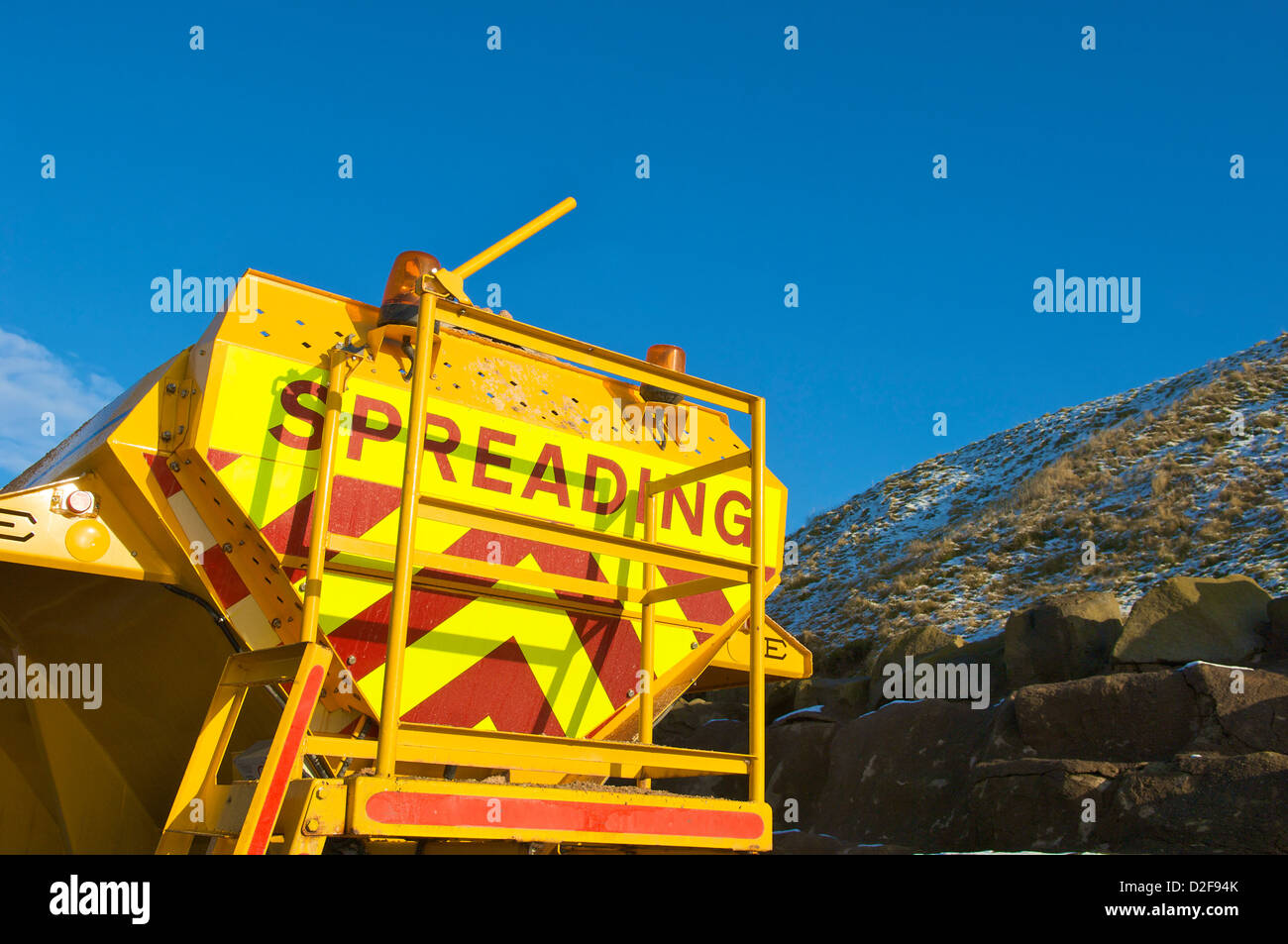 Grit spreader on a cold bright winter day,Blackpool,Lancashire,UK - Stock Image