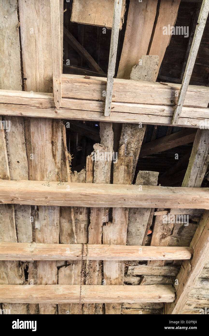 Ruined wooden ceiling in an old farm house Stock Photo