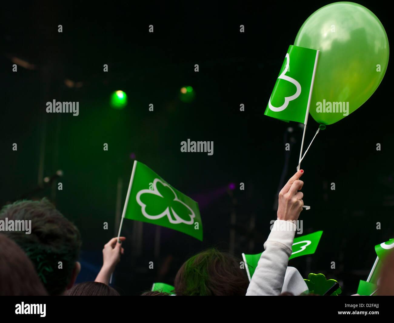 People celebrating St Patricks day in Belfast Northern Ireland - Stock Image