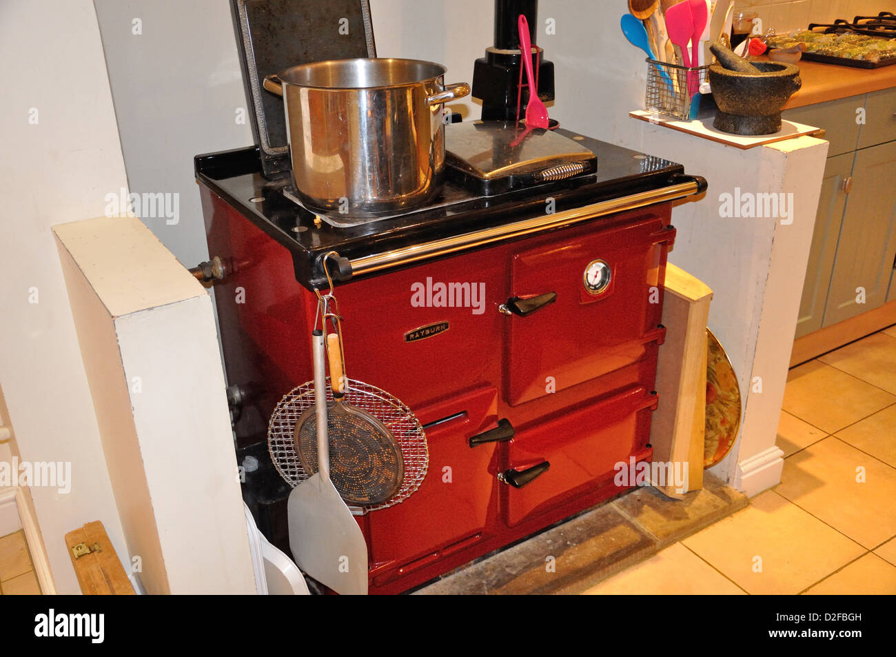 Rayburn cast iron oven in country house kitchen, Sandford on Thames, Oxfordshire, England, United Kingdom - Stock Image