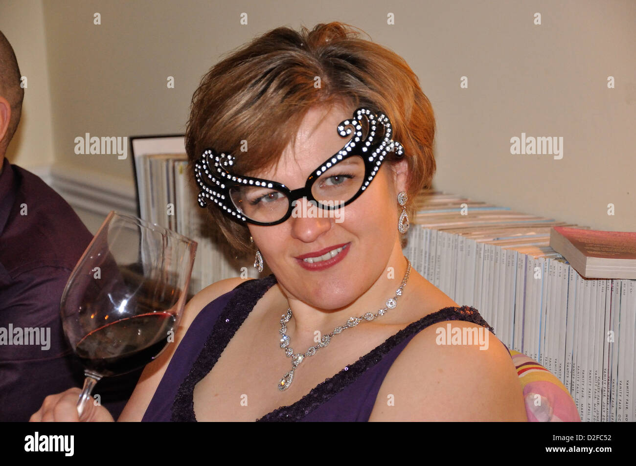 Woman wearing fun glasses at Secret Supper Society dinner, Somerton, Oxfordshire, England, United Kingdom - Stock Image
