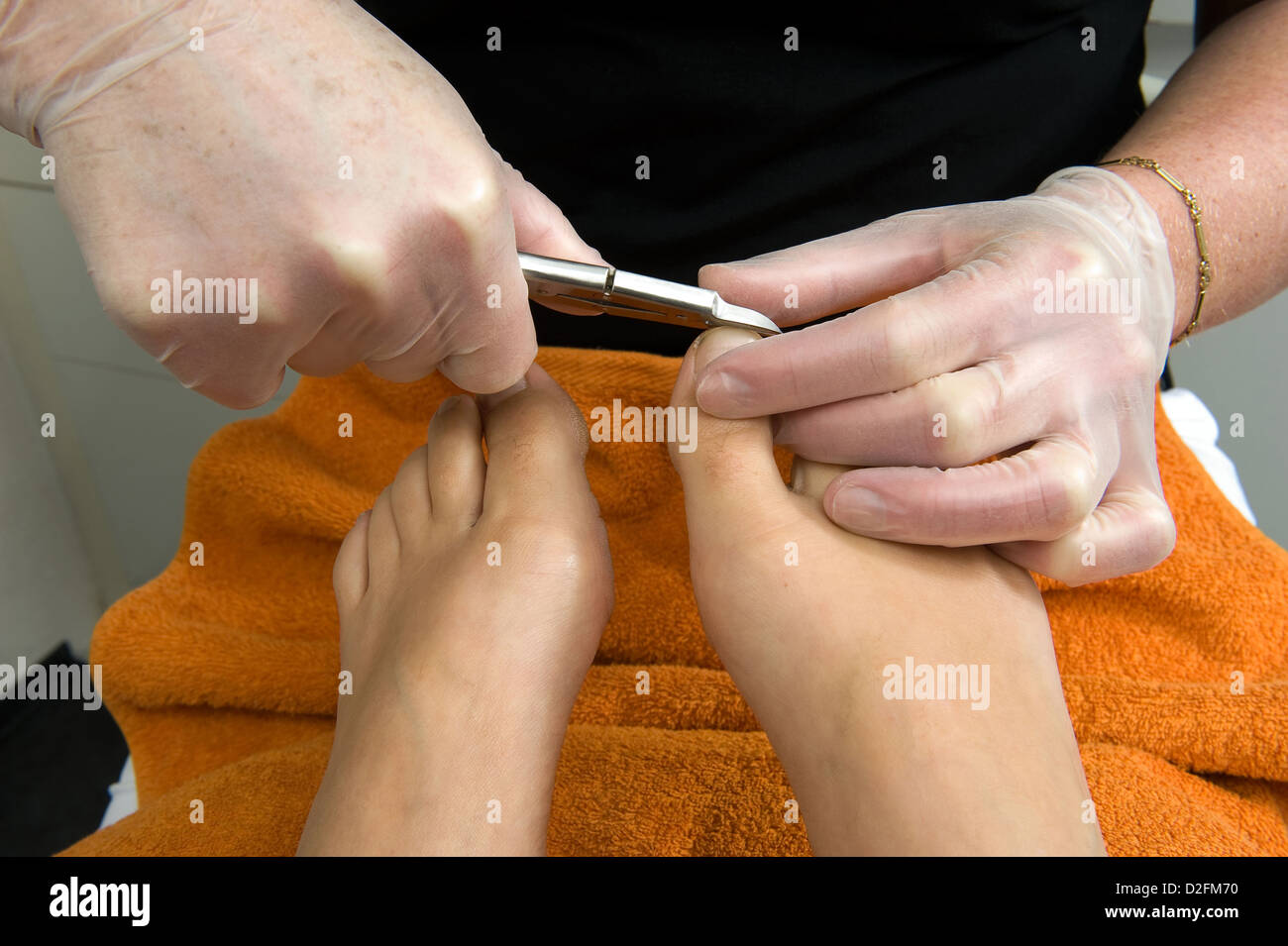A woman's nails are being cut on her toes in a beauty salon - Stock Image