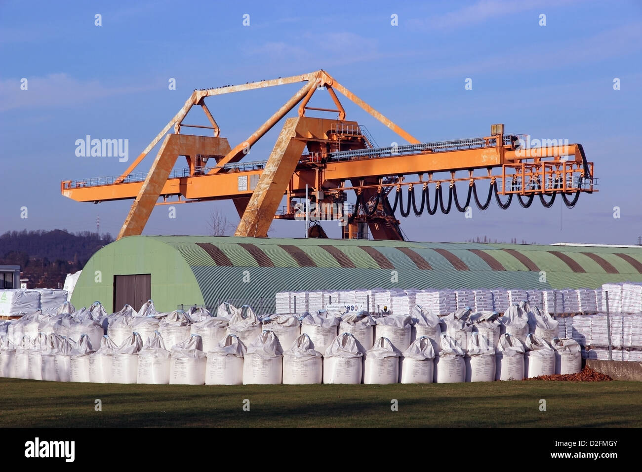 crane with warehouse and bulk bags - Stock Image