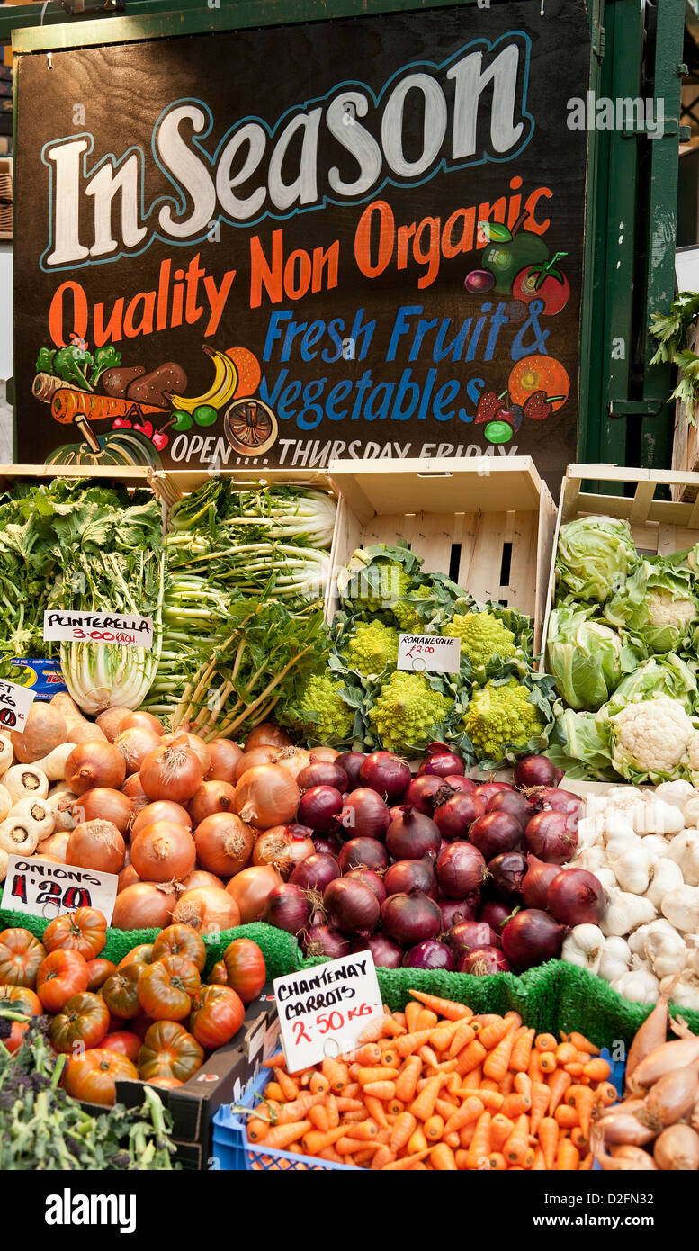 A Borough Market stall selling In Season Quality Non-Organic fresh Fruit and vegetables. London UK - Stock Image
