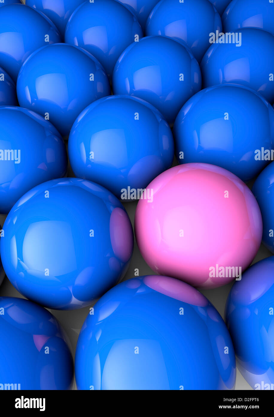 Close up of many blue spheres with one pink one - difference, inequality concept - Stock Image