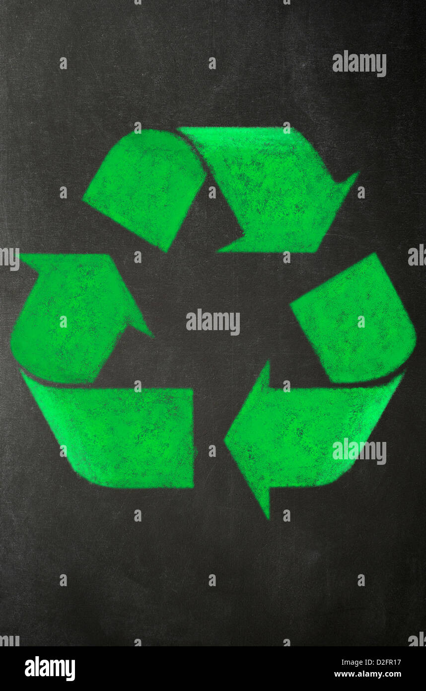 Recycling recycle symbol drawn in green chalk on a blackboard - Stock Image