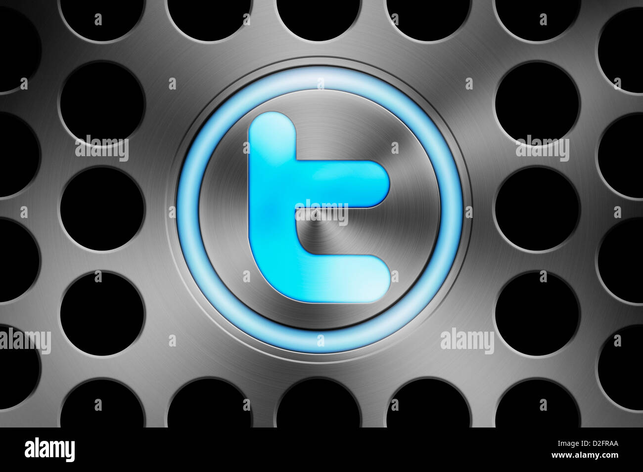 Blue glowing TWITTER icon button on a computer background - Stock Image