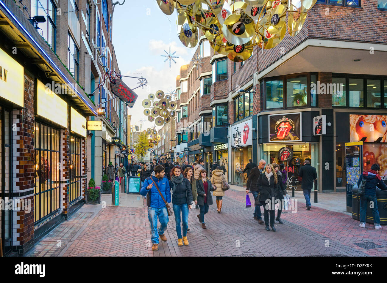 Famous London street, Carnaby street in winter / Christmas, London, UK - with the Rolling Stones shop in background - Stock Image