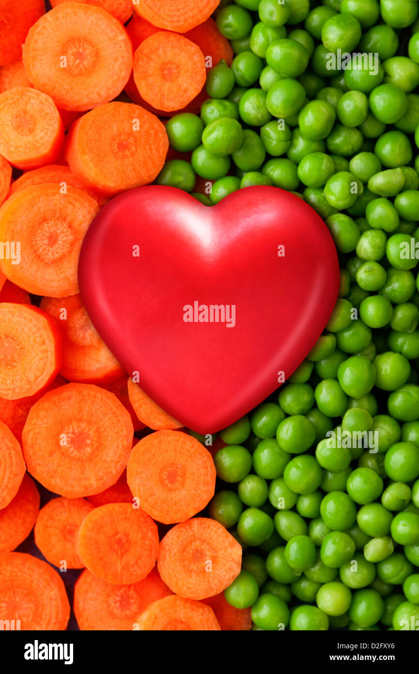 Studio shot healthy food concept shot of vegetables and a heart - Stock Image