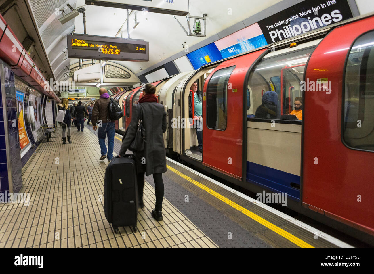 London Underground tube platform, England, UK - Tube train and passengers - Stock Image
