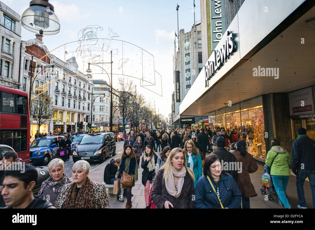 Shoppers on a busy London street, Oxford Street, London, UK - Stock Image