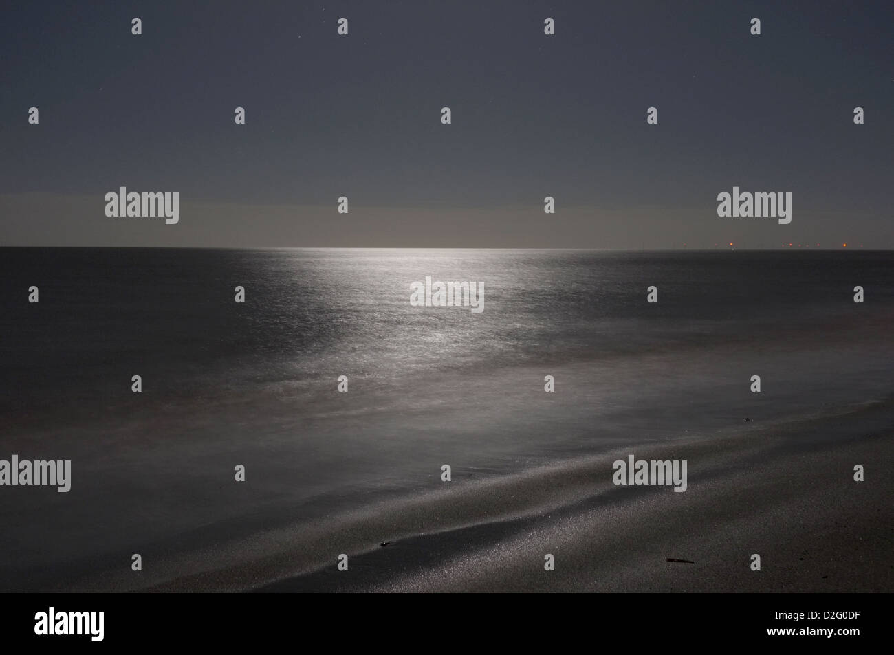 Night on the North sea - the cold sea is calm and flat this dark night - Stock Image
