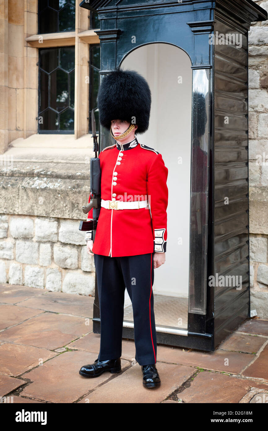 A lone Scots guard on duty at the Tower of London, guarding the entrance to the Jewel House where the Crown Jewels - Stock Image