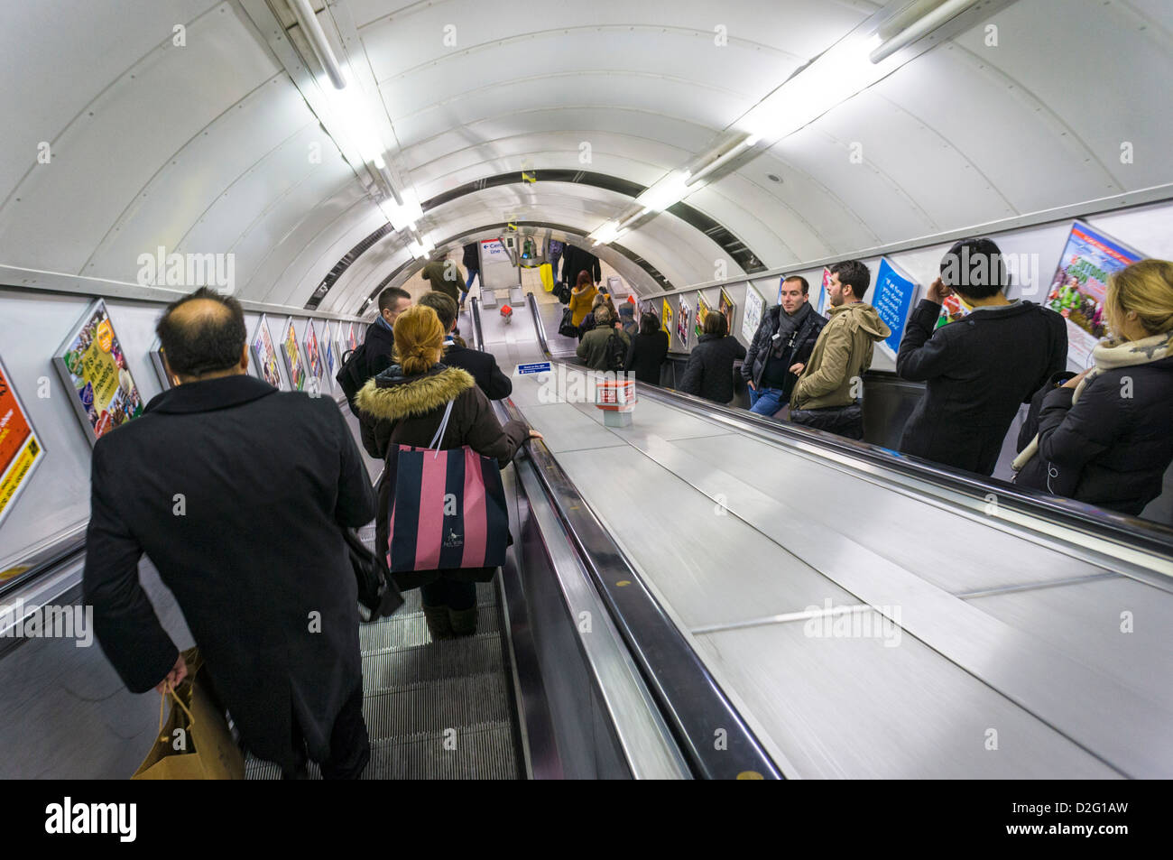 London underground tube station, with people going down the escalator - Stock Image