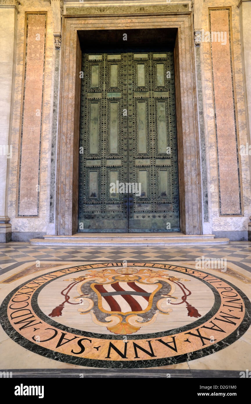 italy, rome, basilica of san giovanni in laterano, entrance, papal coat of arms and bronze door - Stock Image
