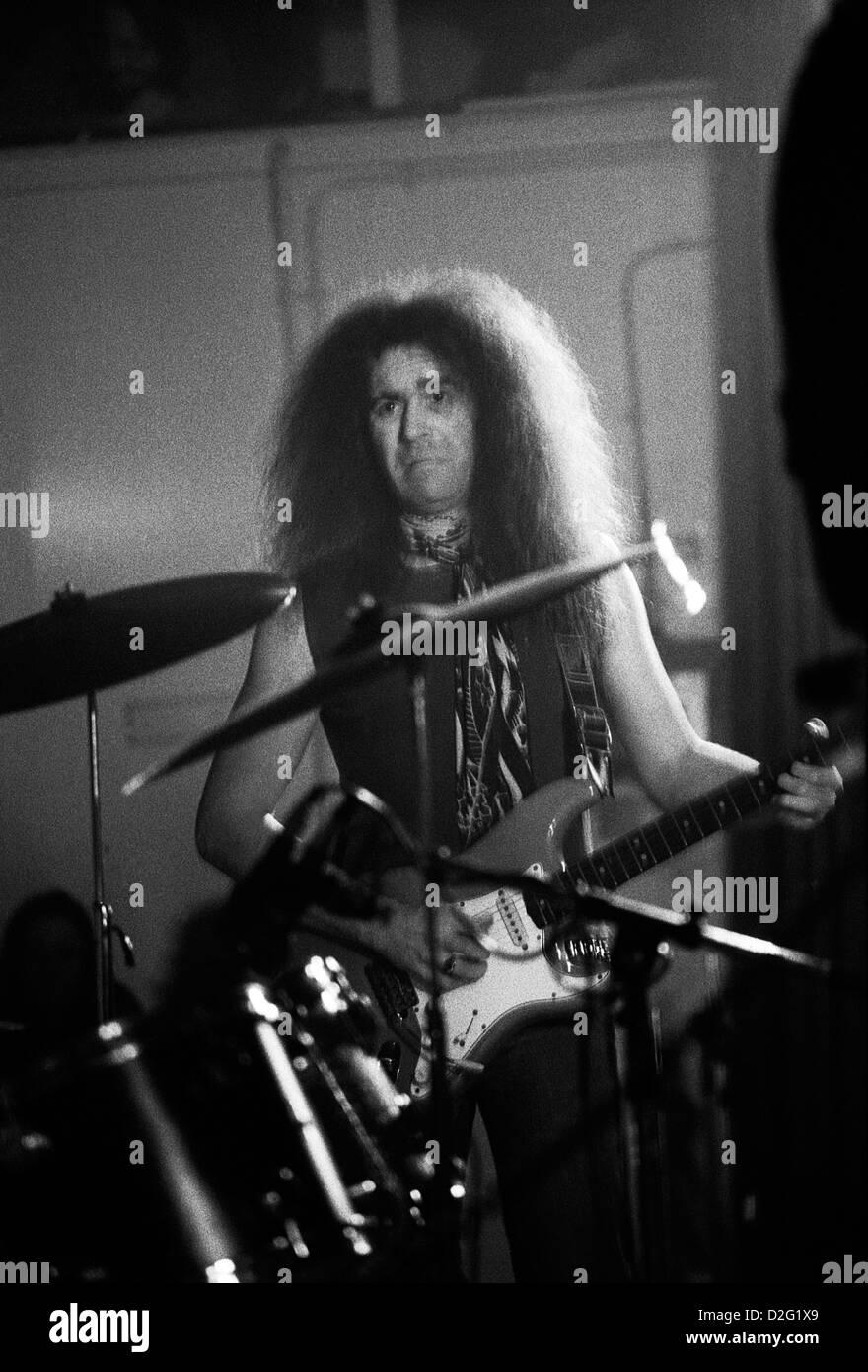 Pink Fairies musician Larry Wallis playing guitar at a gig London England UK 1975  KATHY DEWITT - Stock Image
